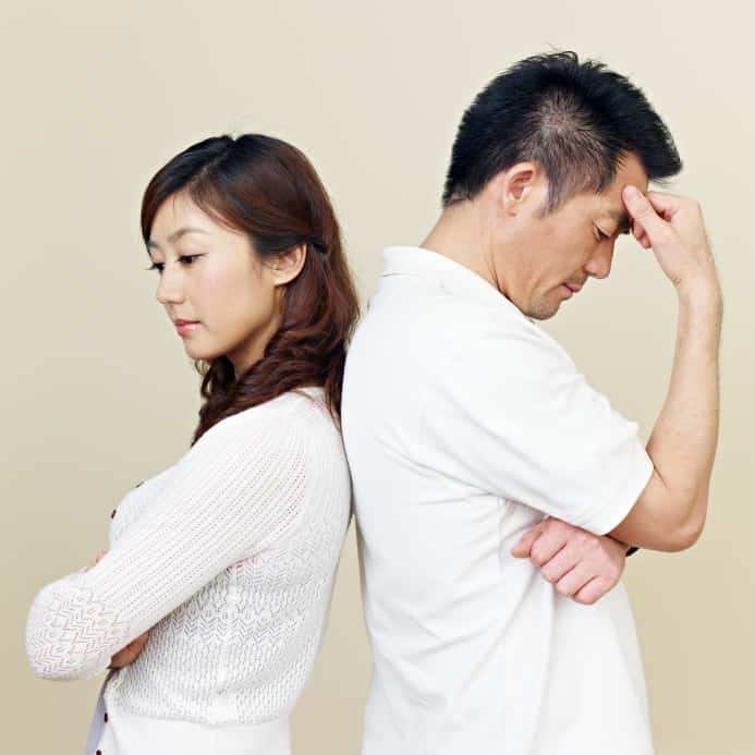 young asian couple having relationship difficulties.