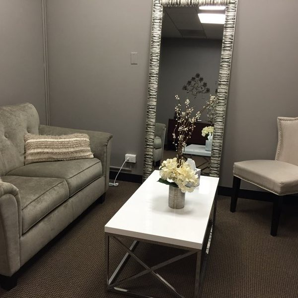 Counseling room in Chicago office with couch and chair and mirror